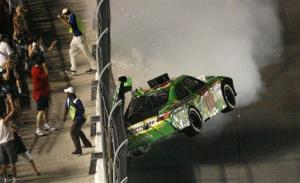 Kyle Busch hits the wall after he was involved in...